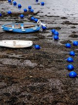 Blue buoys and blue boats