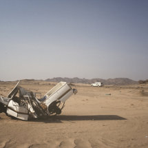 Crashed_Car_like_a_macabre_sculpture_in_the_desert