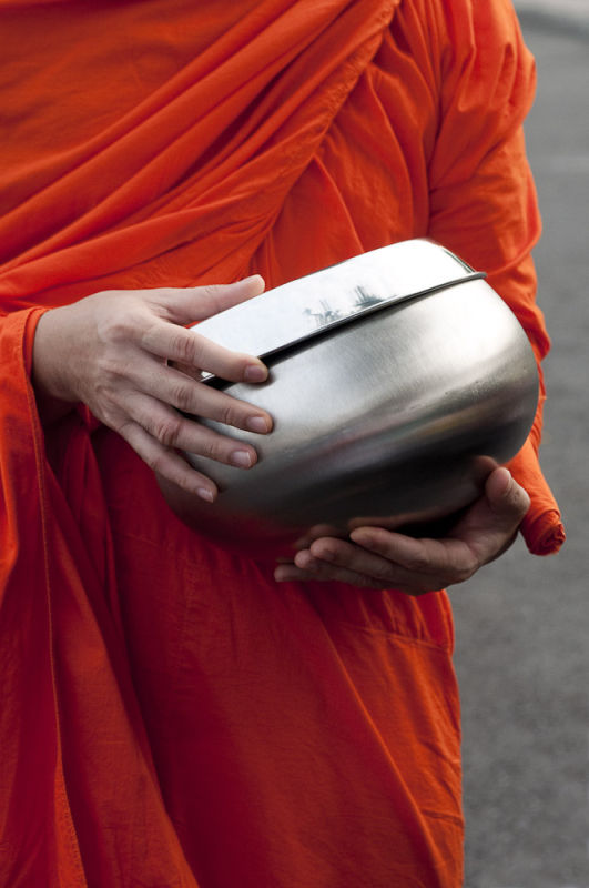 Monk with alms bowl, Bangkok, Thailand