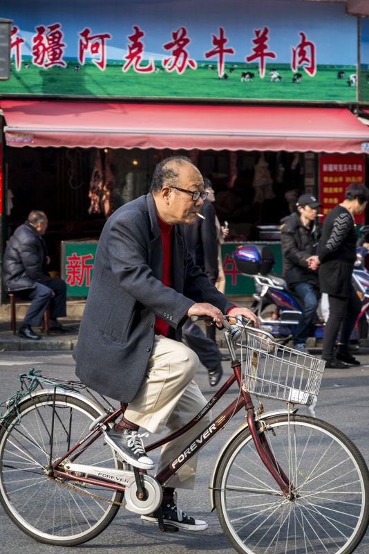 Man smoking a cigarette, Shanghai