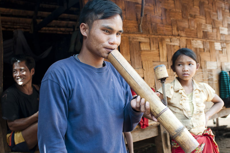 Man smoking water pipe, Bolaven Plateau, Laos