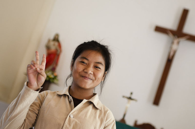 Girl in Catholic Church, Savannakhet, Laos