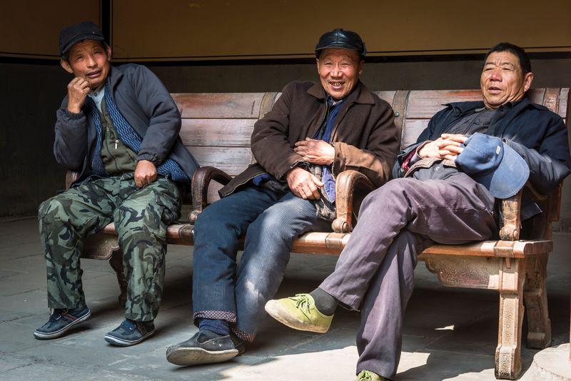 Three men, Qufu, Shandong province