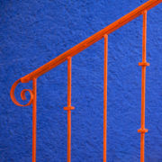 Orange Handrail on Blue Staircase