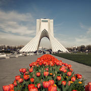 Azadi Monument Behind Red Tulips
