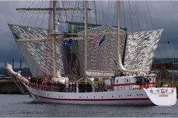 ORP Iskra sailing past Belfast Titanic Museum