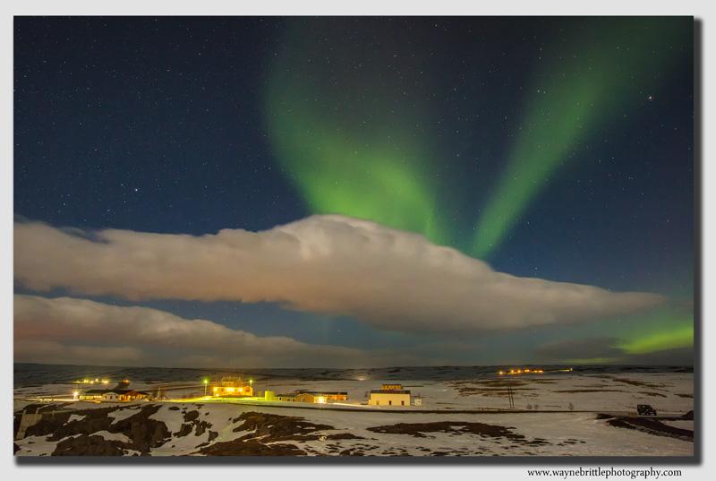 Aurora over Icelandic dwellings