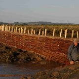 Baz Scampion of Burnham Willow and a nearly completed Erosion project.