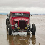 Red Reflections on wet sand