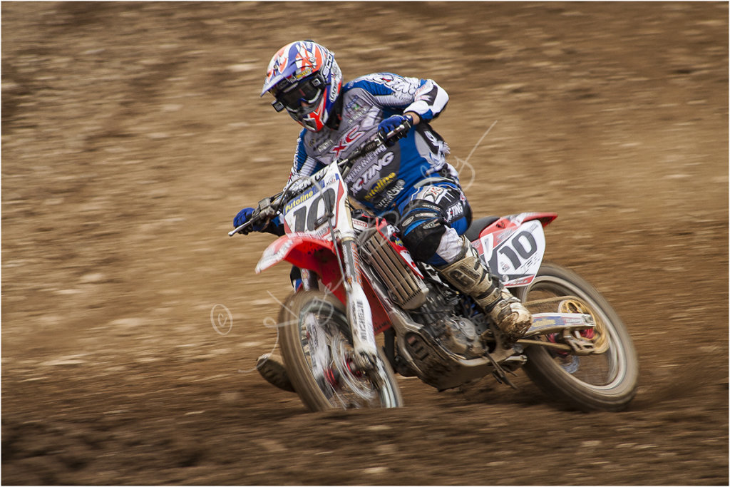 Motocross rider battling on