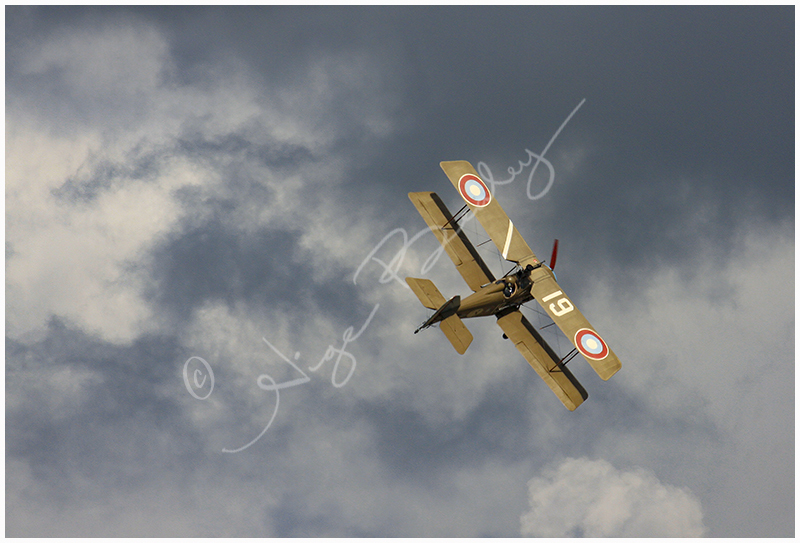 WW1 Bi Plane, against a dramatic sky