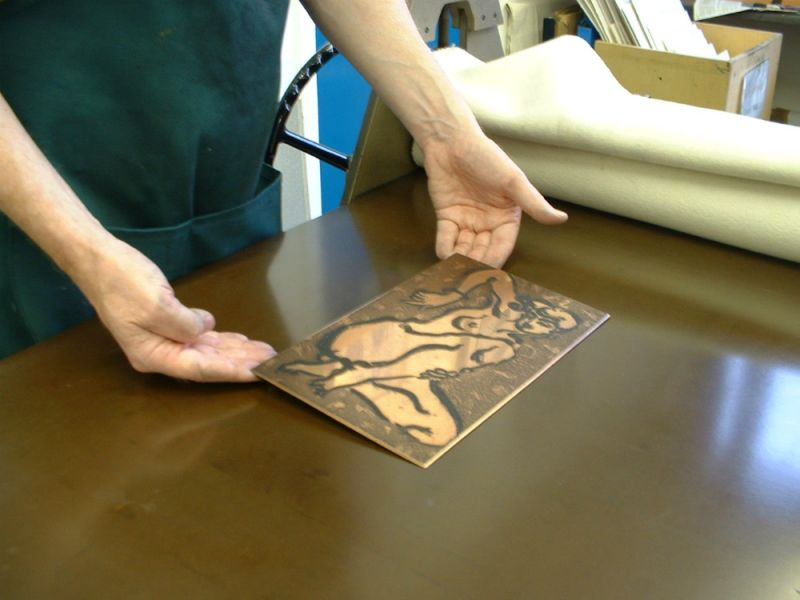 Placing the inked plate on the press bed