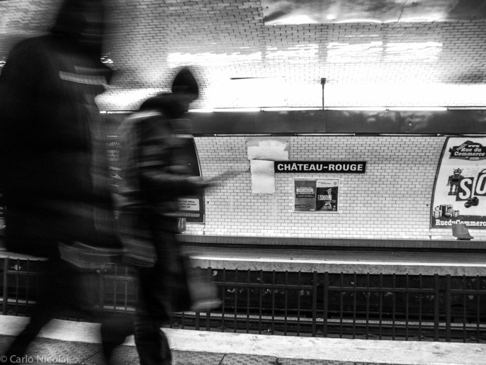 Passengers at the Chateau Rouge Metro station, Paris 2012