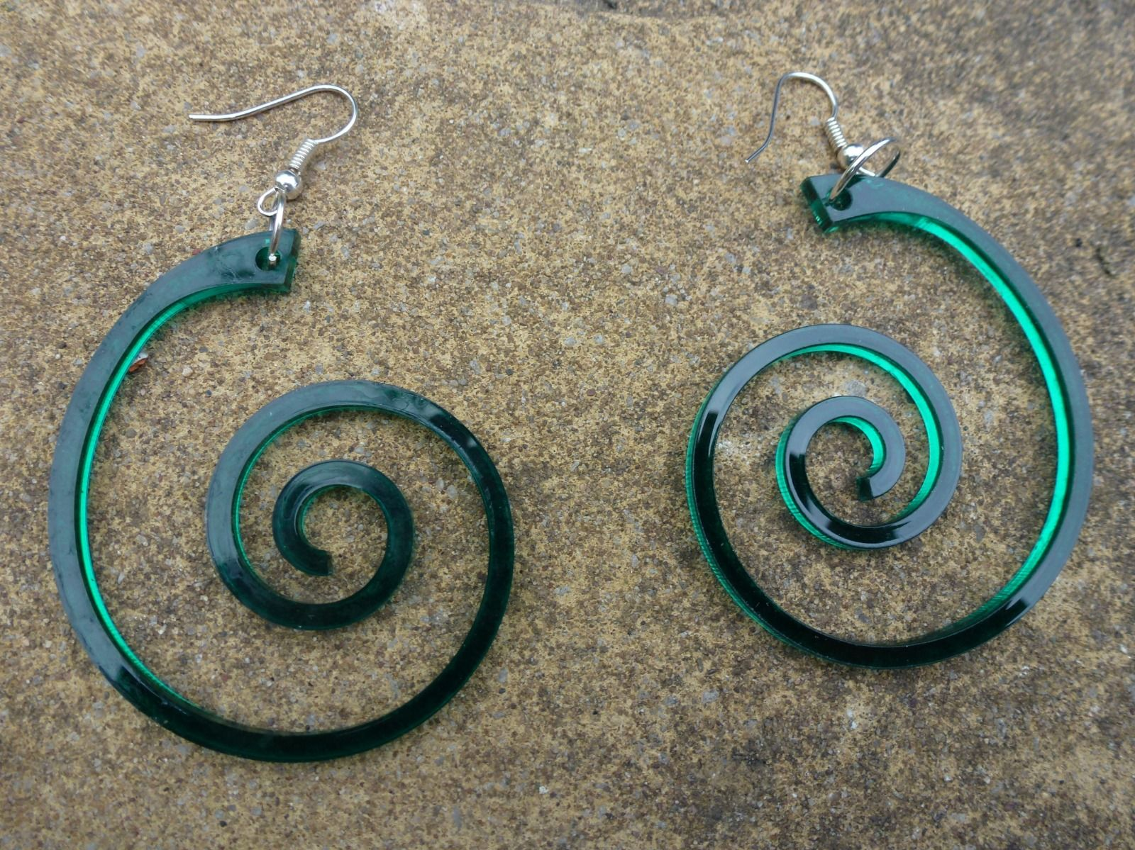 large green transparent spiral earrings