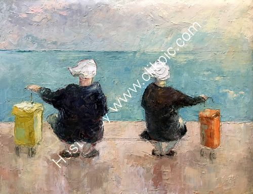 Two ladies sat on bench looking our to sea with their trollies