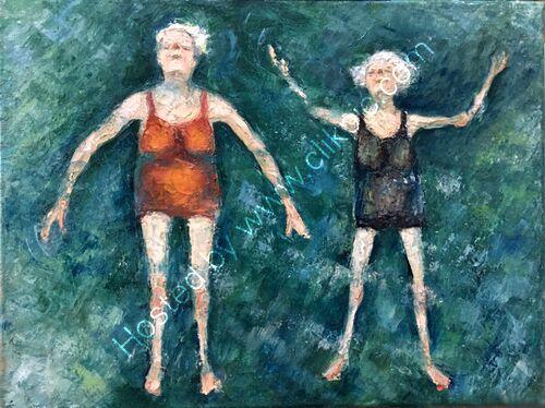 two elderly ladies floating in the sea!