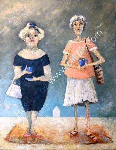 Two ladies drinking tea on a beach