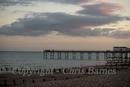 view of Bognor pier sillouetted at sunset