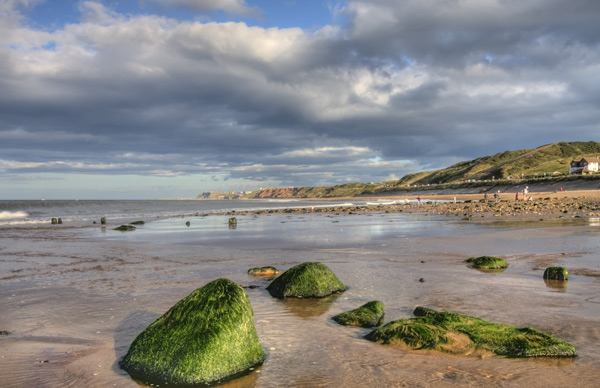 Exploring the beach at Sandsend, North Yorkshire