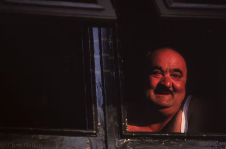 Man at a window. IT. NR25