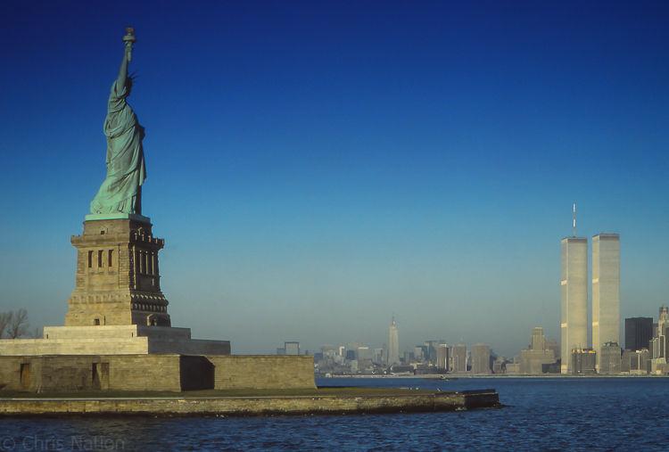 Statue of Liberty & lower Manhatten. N.Y.C.  N.Y. U.S.A. NR25