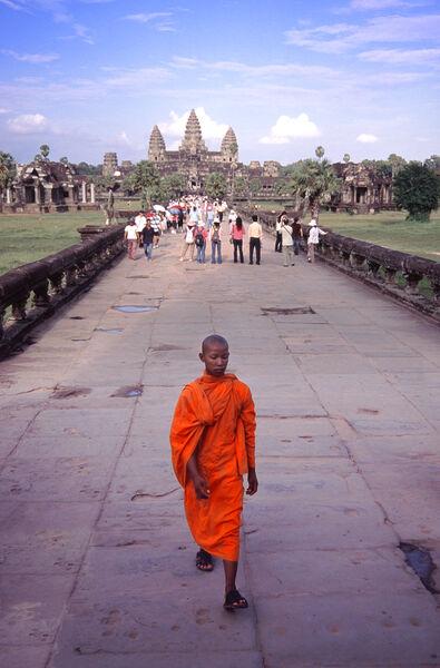 Angkor walkway and monk Cambodia