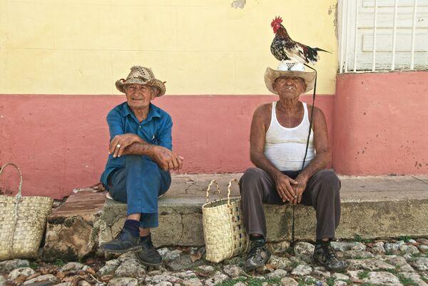 Man and cockerel Trinidad Cuba