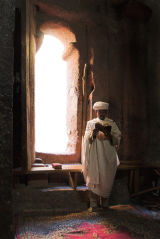 Lalibela priest by window