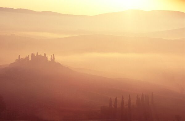 san quirico d'orcia basilica dawn mist Italy