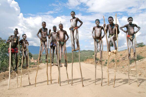 stilt boys Ethiopia