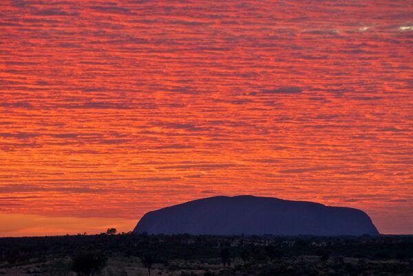 Uluru sunrise red sky Australia