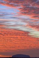 Uluru pink clouds at sunrise