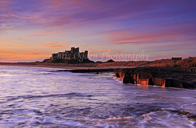 Golden Sunrise Over Bamburgh Castle