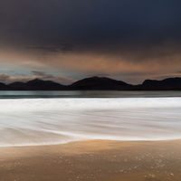 Sunrise and wave Luskentyre