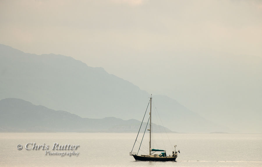 Yacht and misty shore