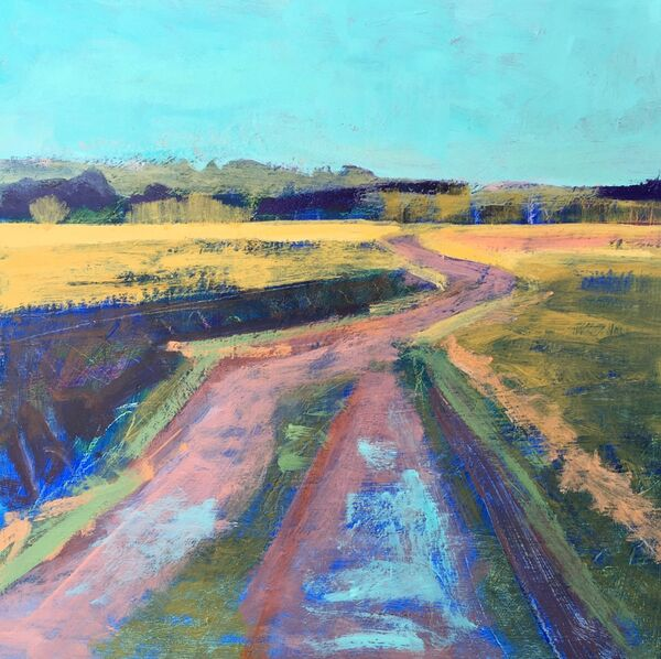 Colourful track through fields teal blue sky yellow crops puddles reflecting teal sky dark trees summer