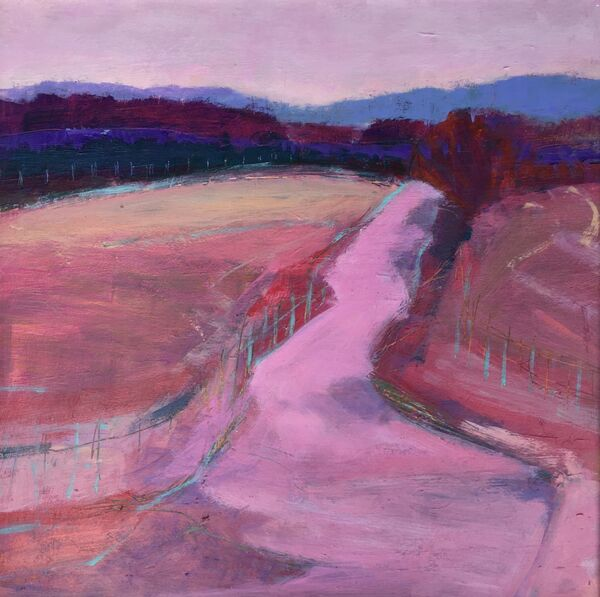 Pink road in glen clova goes up the hill blue hills distance