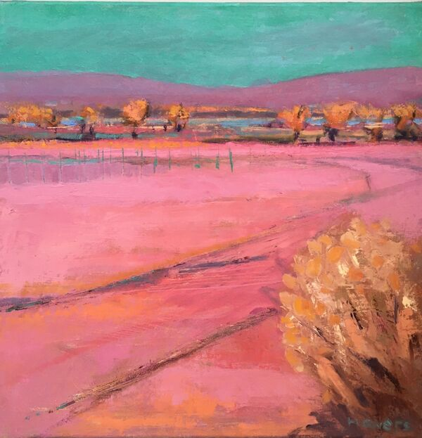 Pink landscape with green sky gold yellow trees blue green water