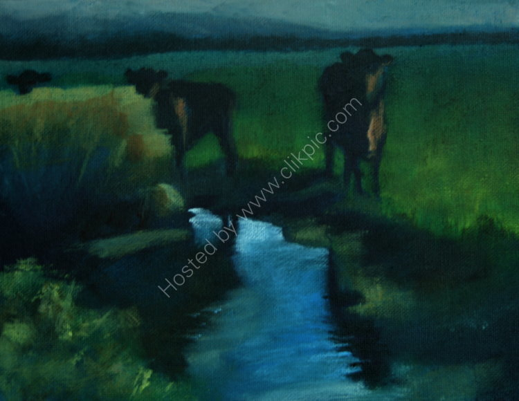 Cows by a stream