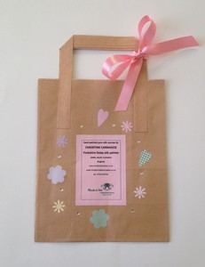 Free gift bag included with each scarf order.