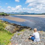 Boy overlooking Borth Y Gest coast
