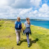 Coastal Walk in summer mother and daughter