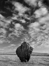 Avebury stone and cloud, Wiltshire, England, UK.