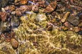 Pebbles, water and light, Brecon Beacons, Wales.
