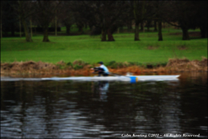 Single sculler on the Liffey.