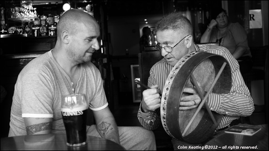 Ned's bodhrán playing sends a member of the audience into a deep sleep