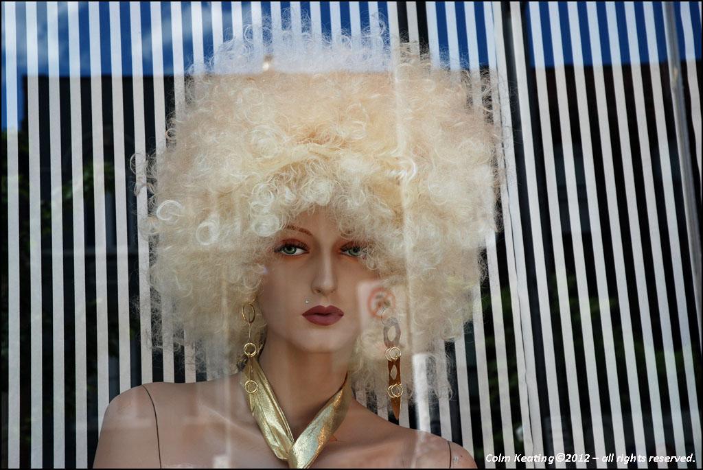 Mannequin in a shop window, off Queen Street, Toronto.