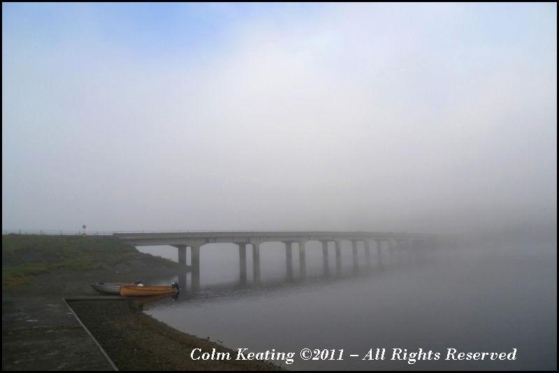 Bridge Shrouded in Fog