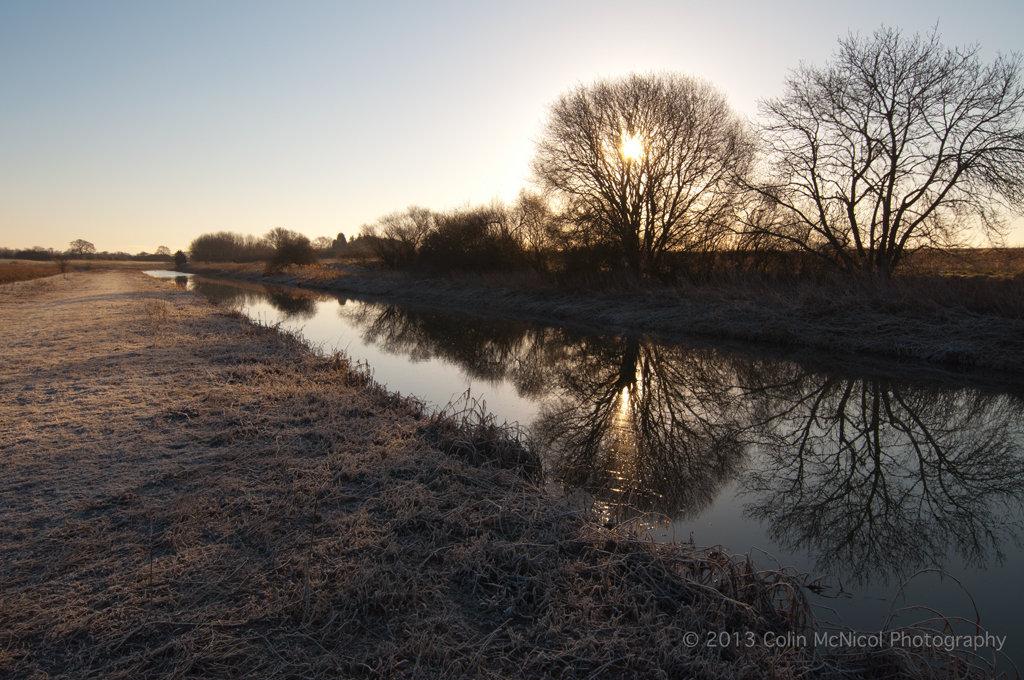 Sunrise through the trees bordering Pocklington Canal