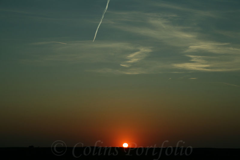 Sunset under the contrails